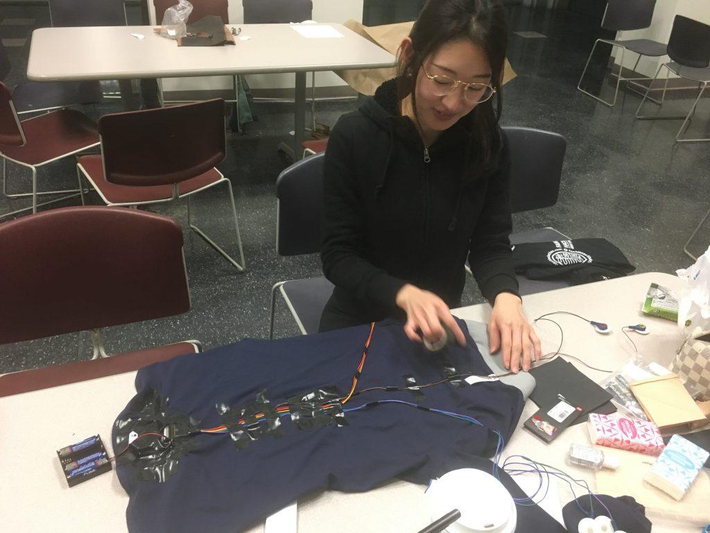 Do Yeon stitching the EMG garment